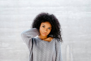 Portrait of a beautiful young woman wearing knit pullover
