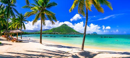 Amazing tropical scenery of beautiful beach and mountain view. Flic en Flac, Mauritius island