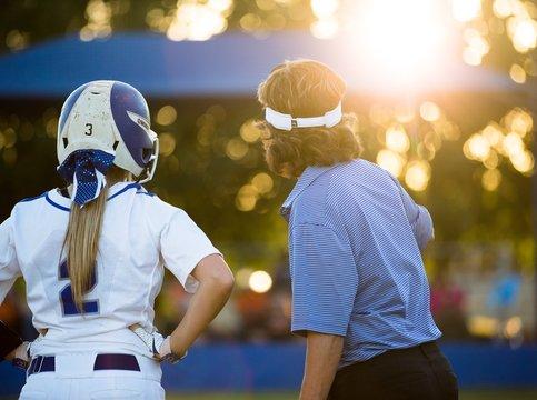 Softball Player & Coach on Third Base