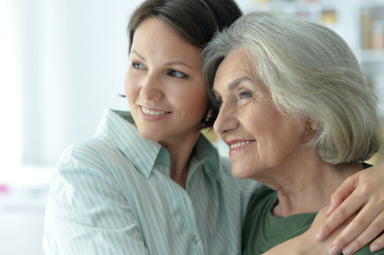 Close up portrait of senior woman with daughter at home