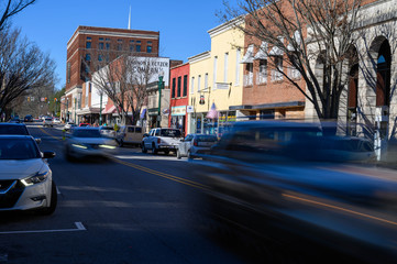 Looking down Union Street in downtown Concord NC. The blurred cars move down the main street. Wall mural