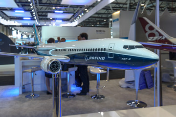 BERLIN, GERMANY - JUNE 01, 2016: The stand of the Boeing Company. Model of jet airliner 737 MAX 8. Exhibition ILA Berlin Air Show 2016.