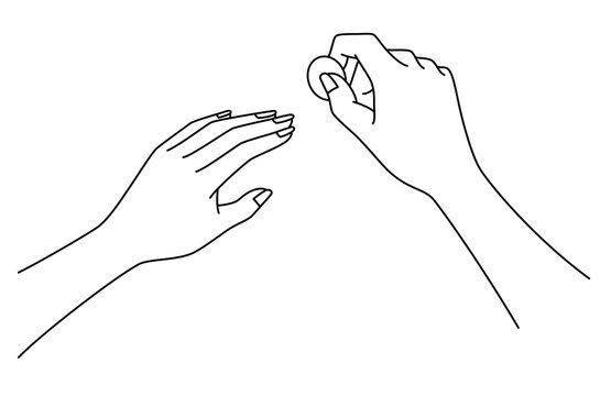 コインで削る女性の手元