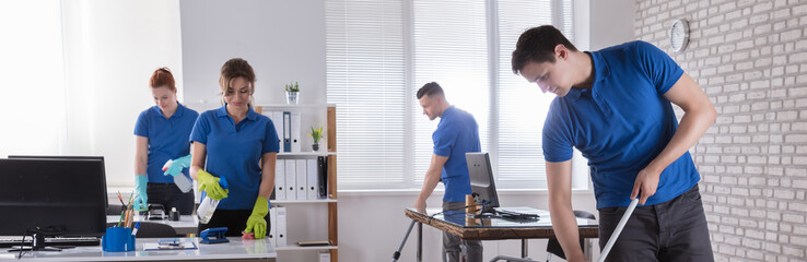 Janitors Cleaning The Office