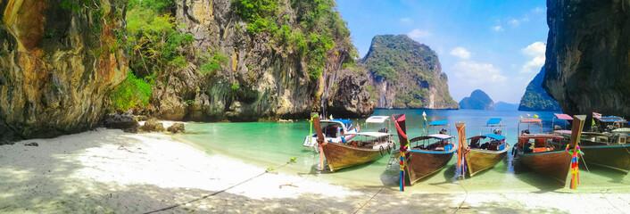 Island beach with limestone rocks and long tail boats Wall mural