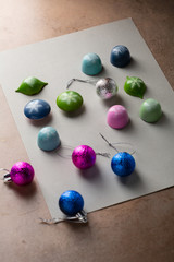 Christmas decorations and luxury candies on gray paper