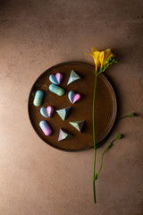 Collection of  Chocolate candy on tray and yellow flower