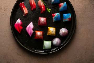 Overhead view of Collection of  Chocolate candy on dark tray