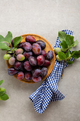 Overhead view of fresh plums on plate