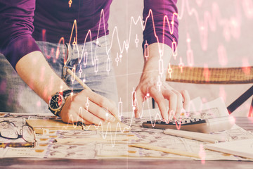 Multi exposure of man standing and planing investment with stock market forex chart.