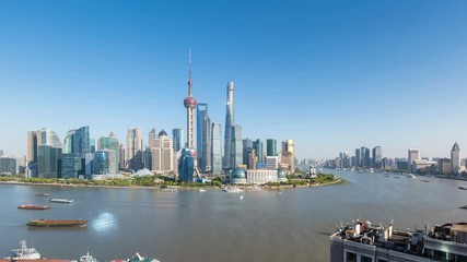 Fotomurales - time lapse of beautiful shanghai cityscape, pudong skyline and busy huangpu river in the afternoon, China