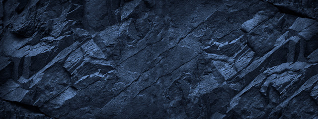 Dark blue grunge background. Deep blue stone background. Toned mountain texture close-up. Banner with copy space for your design. Volumetric rock background. Wall mural