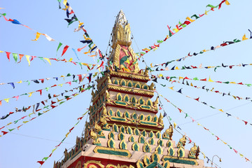 Fotobehang Bedehuis Colorful triangle party flags on sky background for decoration at temple Thailand.