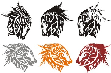Tribal ornate horse head symbols. Set of horse head emblems with eagle feather elements isolated on white for your design