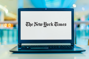 Laptop computer displaying logo of The New York Times