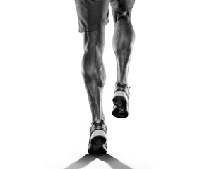 Close up of runners legs isolated on white background
