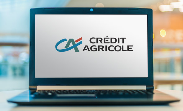 Laptop computer displaying logo of Credit Agricole Group