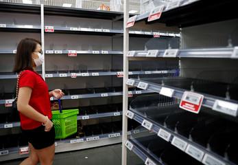 People stock up on food supplies after Singapore raised coronavirus outbreak alert level to orange