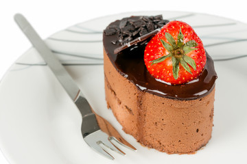Small chocolate cake with strawberry isolated.