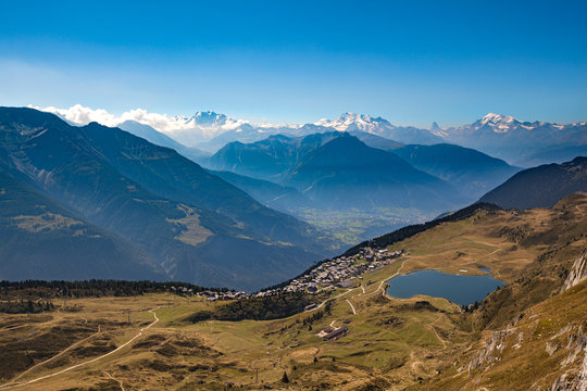 Stunning aerial panorama view of Swiss Alps mountain of Valais (Wallis) and Bettmersee lake above Bettmeralp near Great Aletsch Glacier on sunny day in autumn, blue sky cloud background, Switzerland