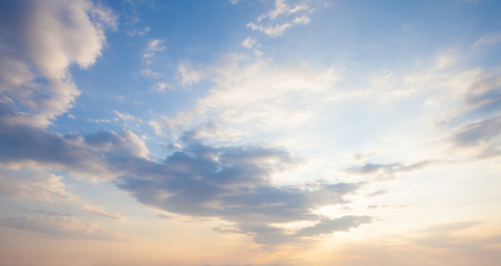 Blue sky clouds background. Beautiful landscape with clouds and orange sun on sky Fotomurales