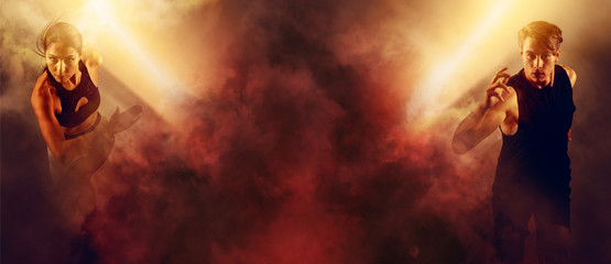 Man and woman running on red smoke background. Sports banner