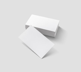 Blank business cards on light gray background. Mockup for branding identity. Isolated with clipping...