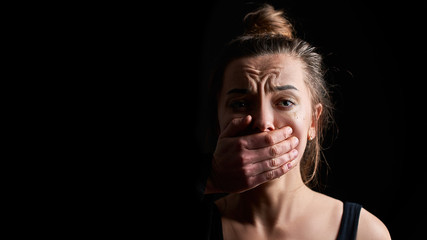 Stressed unhappy crying woman victim in fear suffering from female domestic violence having life difficulties and social problems