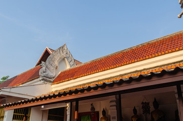 Wall Murals Place of worship roof of thai temple in thailand