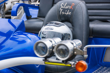 Uzhgorod, Ukraine - JUL 09, 2016: silverR trike detail shots. beautiful custom three wheel motorcycle in blue color