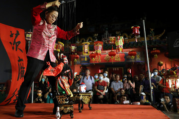 Performer presents traditional Chinese puppet show during Cap Go Meh festival in Kuala Lumpur