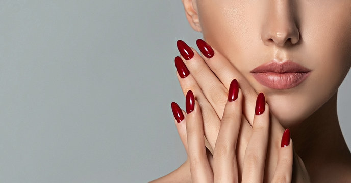 Beautiful girl   . Model woman showing  red  shellac manicure on nails   . Cosmetics ,beauty and makeup
