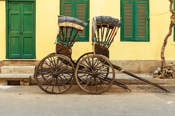 Hand pulled rickshaws are parkedon the street. Kolkata. India