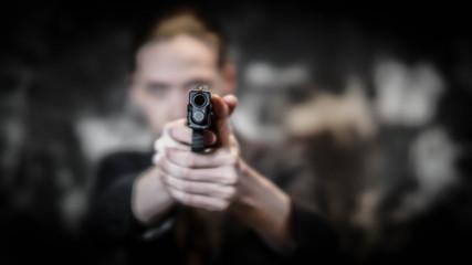 Man holding gun preparing to shoot. Personal defense concept.
