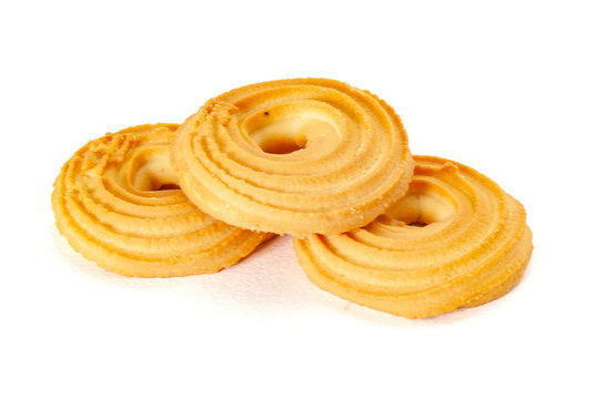 Round spritz shortbread isolated on white background. Danish butter cookies on white.