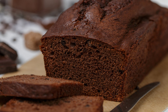 Sliced homemade chocolate banana pound cake loaf. Delicious dessert for Breakfast. A treat for tea. Selective focus