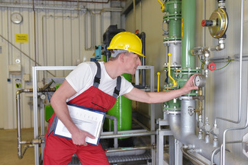 Mechanics repair and inspect an industrial plant in a modern factory