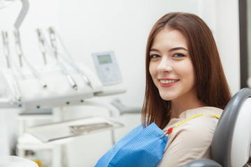 Young woman having medical appointment at dental clinic