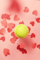 tennis love layout tennis ball flying hearts confetti. Valentine's day concept with tennis play.