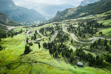 Wall Mural - Aerial view of winding road at Passo Gardena, Dolomites, Europe