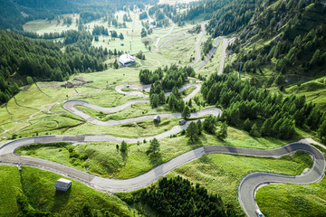 Wall Mural - Serpentine leading to Passo Gardena in Dolomites