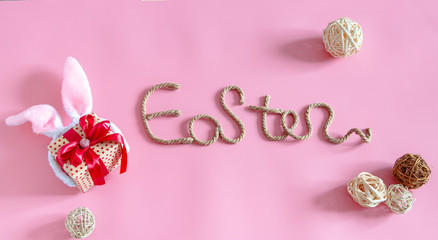 Easter creative inscription on a pink background .