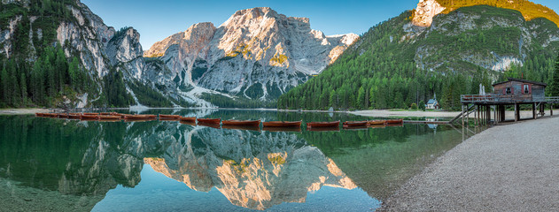 Wall Mural - Wooden boats and Lago di Braies in Dolomites, Italy, Europe