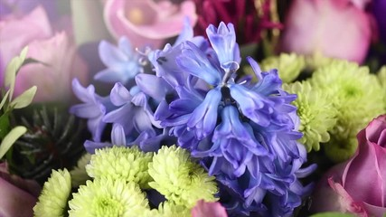 Fotoväggar - Bouquet of beautiful flowers. Party. Beauty fashion Designed bunch of flowers for holiday, celebrating. Valentine's Day, birthday, Colorful. Rotating on purple background. Slow motion 4K UHD