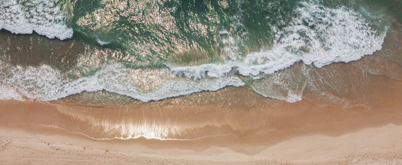 Aerial view of beautiful sandy beach and sea waves, summer holidays travel tourism, relaxing and wellness concept