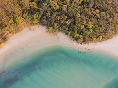 Aerial view of beautiful turquoise sea ocean, beach and tree forest walk, Top view from drone,  reopen tourism