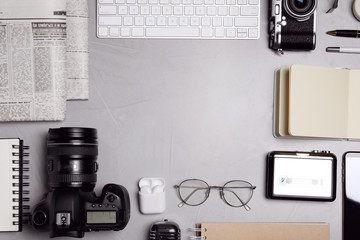 Flat lay composition with equipment for journalist on grey stone table. Space for text