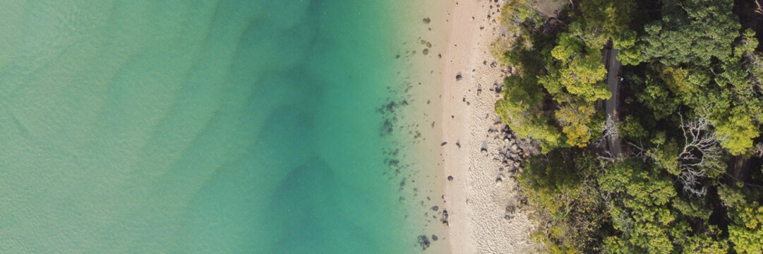 Aerial view of beautiful turquoise sea ocean, beach and tree forest walk, Top view from drone,  reopen tourism concept