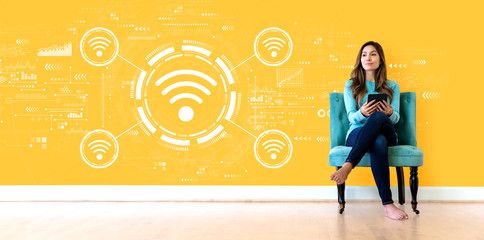 Wifi theme with young woman holding a tablet computer