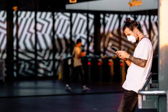 A young man checking coronavirus symptoms in his phone